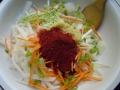 Koreanische Chiliflocken (Gochugaru) dazugeben